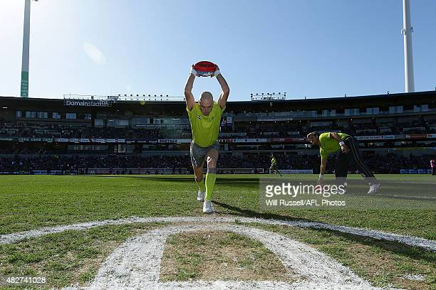 Umpire Mathew Nicholls practices a centre bounce before he round 18 AFL match between the Fremantle Dockers and the Greater Western Sydney Giants at...