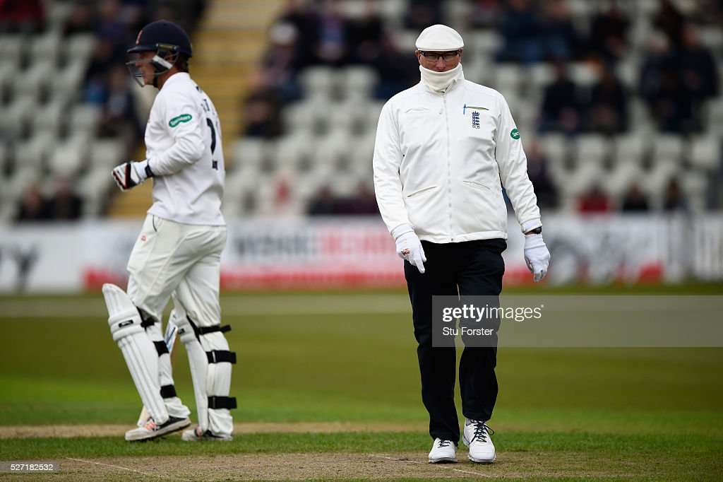 Umpire Neil Mallender in white gloves during day two of the Specsavers County Championship Division Two match between Worcestershire and Essex at New Road on May 2, 2016 in Worcester, England.