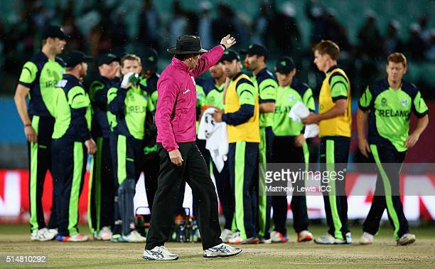 Umpire Nigel Llong waves off the Ireland team as rain stops play during the ICC World Twenty20 India 2016 match between Bangladesh and Ireland at the...