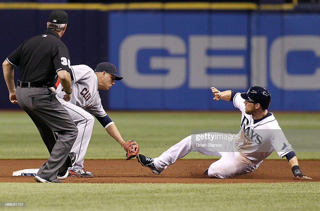 Umpire Paul Nauert #39 looks on as shortstop Asdrubal Cabrera #13 of the Cleveland Indians catches Ben Zobrist #18 of the Tampa Bay Rays attempting to steal second base to end the first inning of a game on May 9, 2014 at Tropicana Field in St. Petersburg, Florida.
