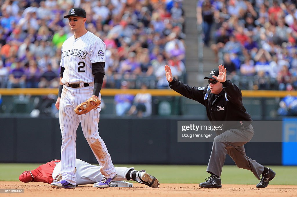 Umpire Paul Schrieber calls timeout as Gerardo Parra #8 of the Arizona Diamondbacks slides safe into second with a double as shortstop Troy Tulowitzki #2 of the Colorado Rockies collects the ball at Coors Field on April 21, 2013 in Denver, Colorado. The Diamondbacks defeated the Rockies 5-4.