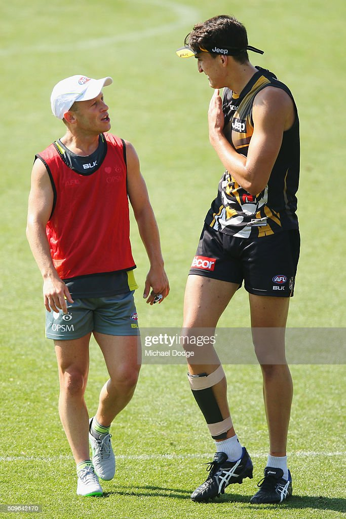 Umpire Ray Chamberlain explains a rule to Ivan Soldo during the Richmond Tigers AFL intra-club match at Punt Road Oval on February 12, 2016 in Melbourne, Australia.