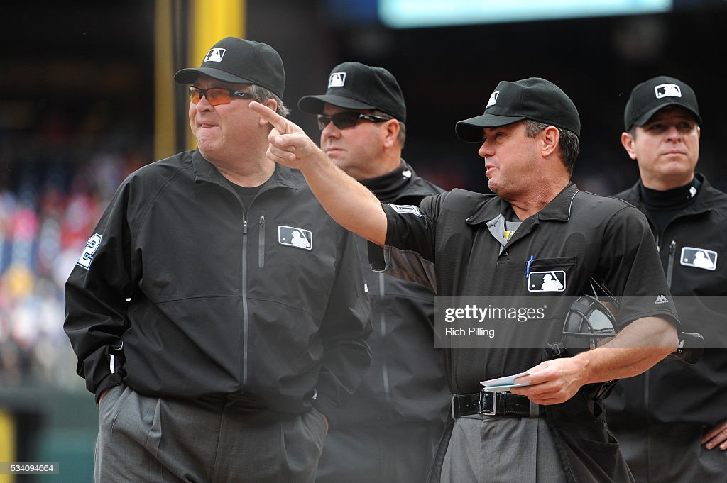 MLB umpire Rob Drake and the rest of the umpire crew go over the ground rules prior to the game between the Philadelphia Phillies and the Atlanta...