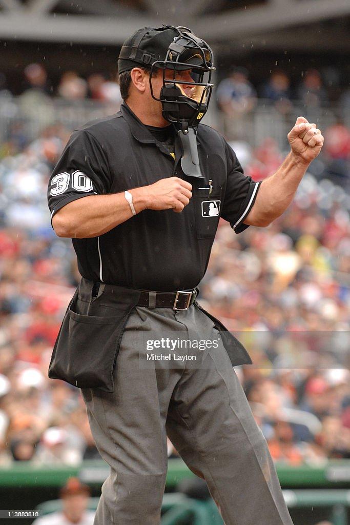 Umpire Rob Drake calls a strike during a baseball game between the San Francisco Giants and the Washington Nationals on May 1 2011 at Nationals Park...