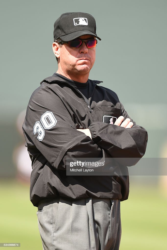Umpire Rob Drake looks on during a baseball game between the Baltimore Orioles and the Seattle Mariners at Oriole Park at Camden Yards on May 19 2016...