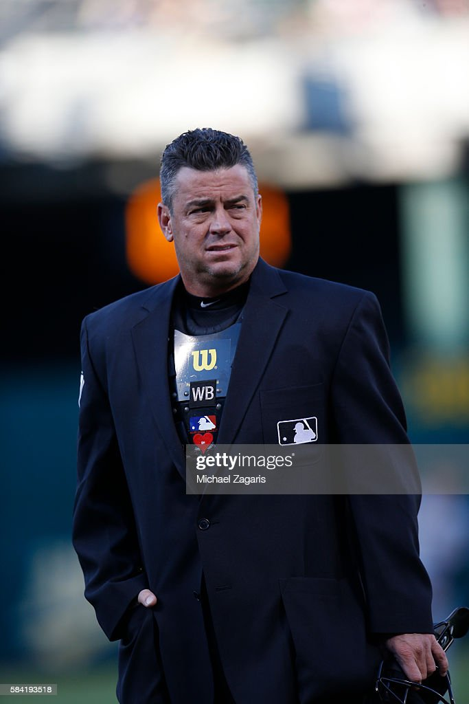 Umpire Rob Drake stands on the field during the game between the Pittsburgh Pirates and the Oakland Athletics at the Oakland Coliseum on July 2 2016...