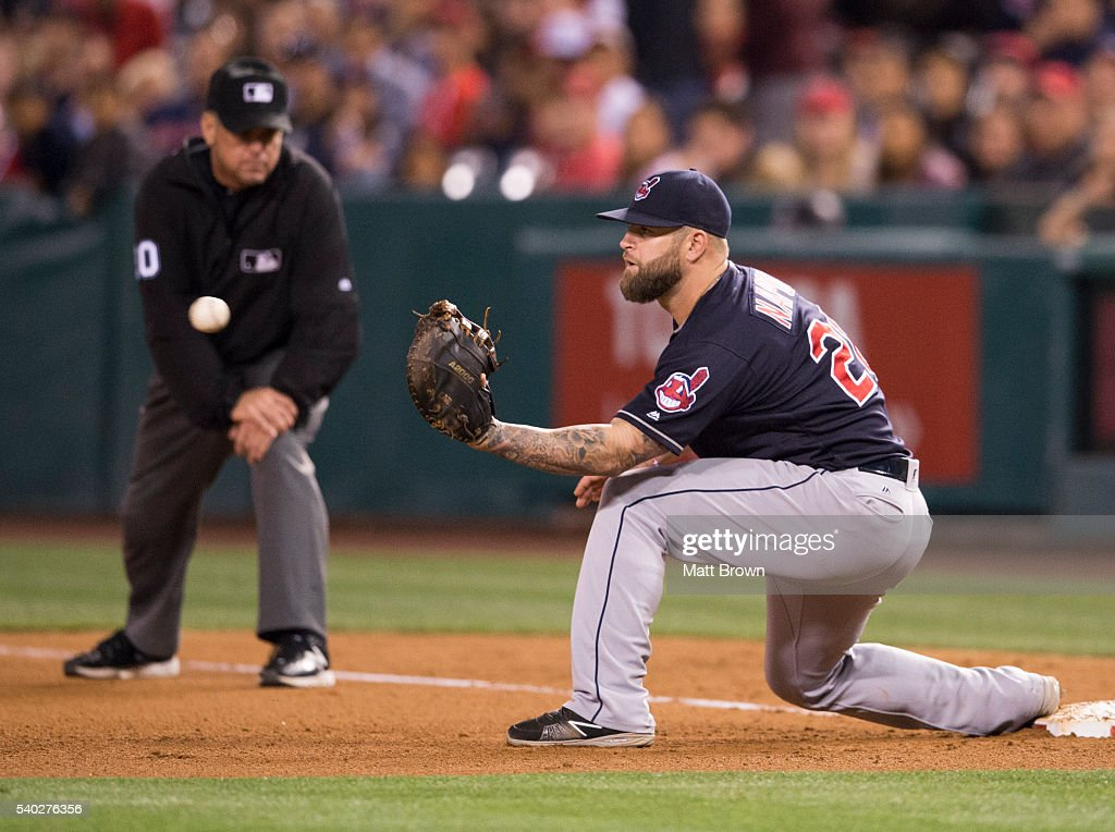 Umpire Rob Drake watches Mike Napoli of the Cleveland Indians catch a force out during the seventh inning of the game against the Los Angeles Angels...
