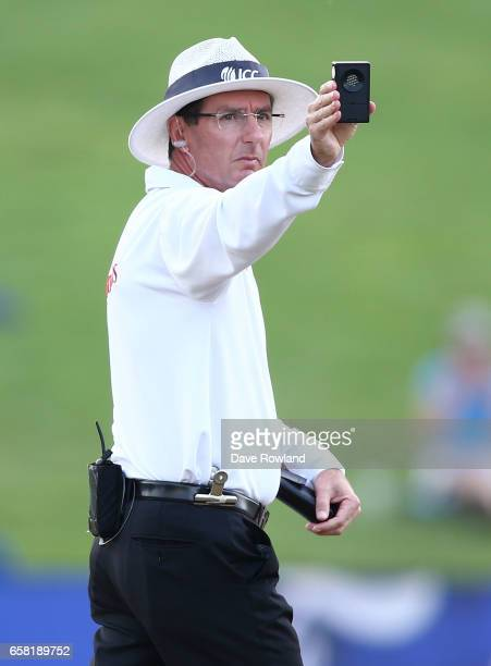 Umpire Rod Tucker checks the light during day three of the Test match between New Zealand and South Africa at Seddon Park on March 27 2017 in...