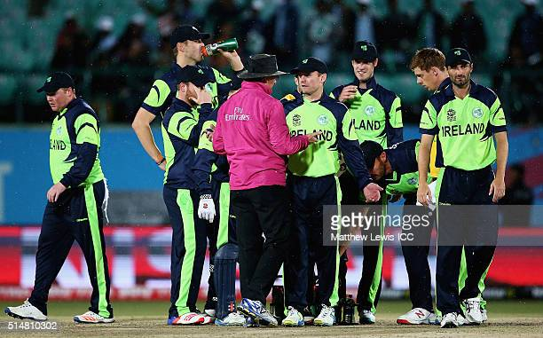 Umpire Rod Tucker talks to the Ireland players before coming off for rain during the ICC World Twenty20 India 2016 match between Bangladesh and...
