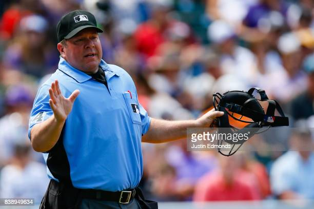 Umpire Sam Holbrook in action during a game between the Milwaukee Brewers and Colorado Rockies at Coors Field on August 20 2017 in Denver Colorado