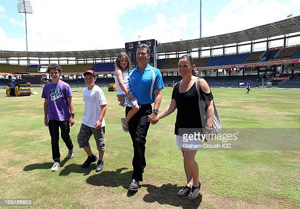 Umpire Simon Taufel with wife Helen and children Harry Jack 11 and Sophie 5 on the oval after a press conference to announce his decision to step...