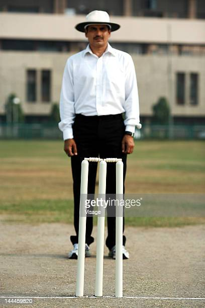 Umpire standing behind wickets