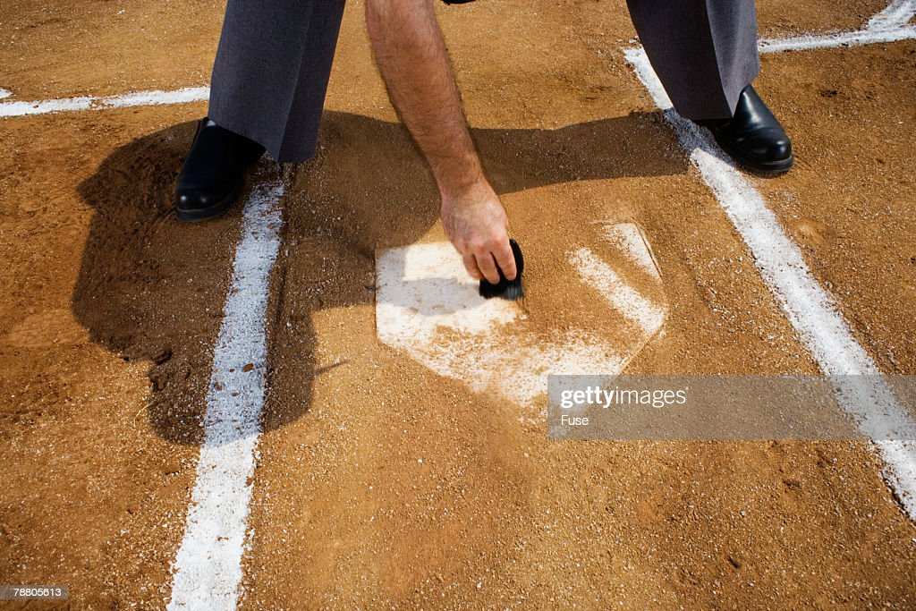 Umpire Sweeping Home Plate