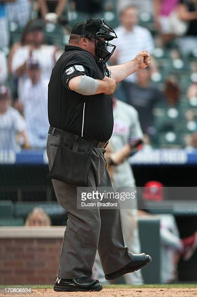 Umpire Wally Bell signals a strike out to end the game during a game between the Colorado Rockies and the Philadelphia Phillies at Coors Field on...