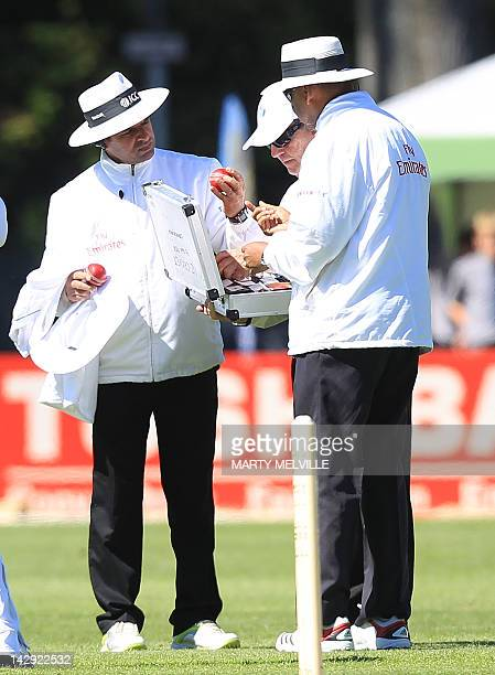 Umpirers Aleem Dar and BR Doctrove check the new match ball during day two of the first five day international cricket test match between New Zealand...