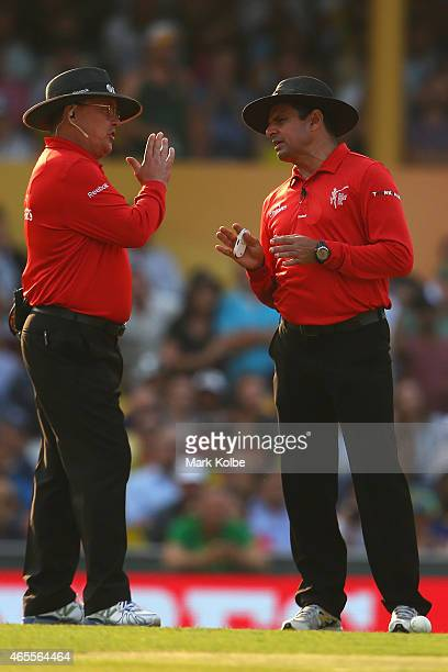 Umpires Aleem Dar and Ian Gould speak during the 2015 ICC Cricket World Cup match between Australia and Sri Lanka at Sydney Cricket Ground on March 8...
