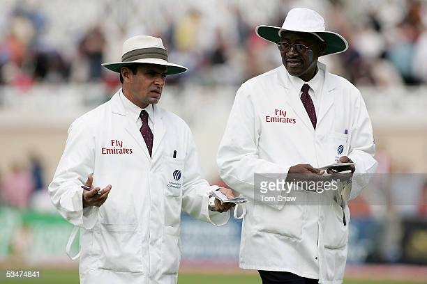Umpires Aleem Dar of Pakistan and Steve Bucknor of West Indies talk during day four of the Fourth npower Ashes Test between England and Australia on...