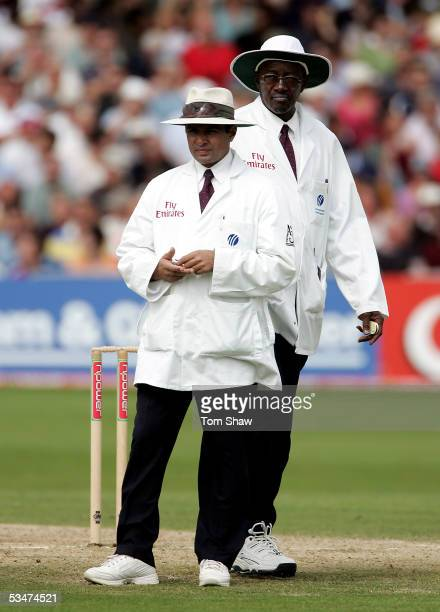 Umpires Aleem Dar of Pakistan and Steve Bucknor of West Indies watch on during day four of the Fourth npower Ashes Test between England and Australia...