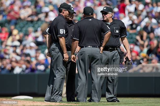 Umpires Angel Hernandez Doug Eddings Adrian Johnson and Dana DeMuth discuss a call and decide to go and use video replay to confirm the call on the...