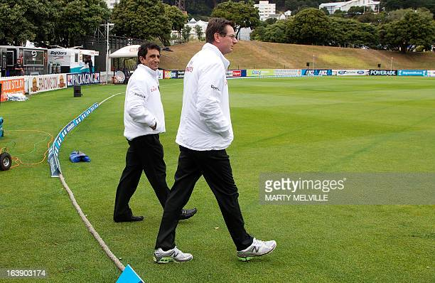 Umpires Asad Rauf of Pakistan and RJ Tucker of Australia walk out to check the pitch as rain halts play during day five of the international cricket...