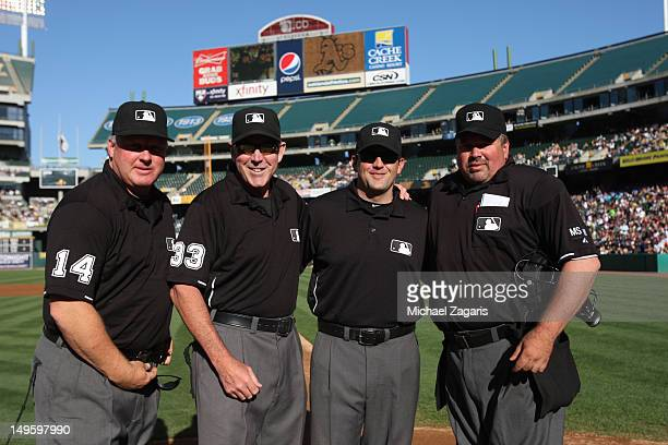 Umpires Bill Miller Brian Knight and Wally Bell honor Mike Winters on umpiring his 3000 game prior to the game between the New York Yankees and the...