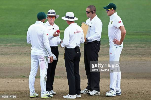 Umpires Bruce Oxenford and Rod Tucker discuss the state of the ball with Captain Faf du Plessis of South Africa during day three of the Test match...