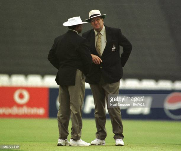 Umpires Dyrell Hair and Javed Akhtar decide to bring the players off for bad light