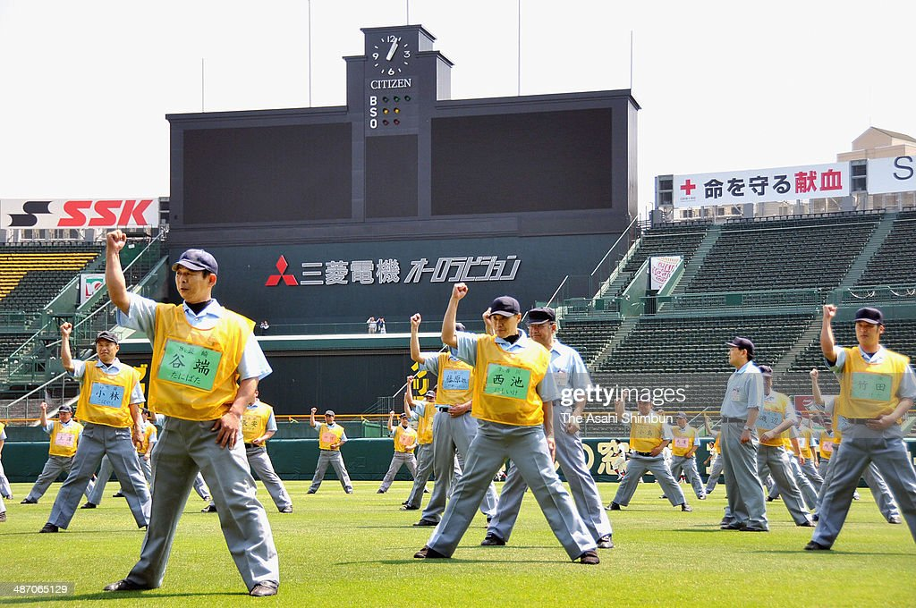 Umpires from all 47 prefectures call 'Out' during a training session at Hanshin Koshien Stadium on April 26 2014 in Nishinomiya Hyogo Japan