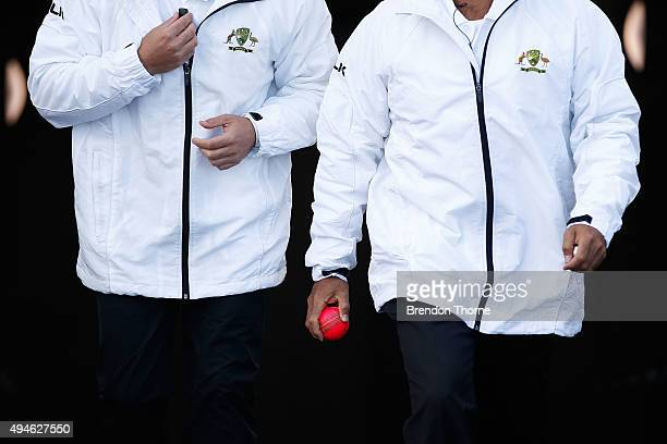 Umpires Gerard Abood and Shawn Craig walk to the middle with the pink ball after the tea break during day one of the Sheffield Shield match between...