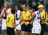 Umpires Hayden Kennedy and Matthew Nicholls discuss the end of the match after the round five AFL match between the St Kilda Saints and the Fremantle...