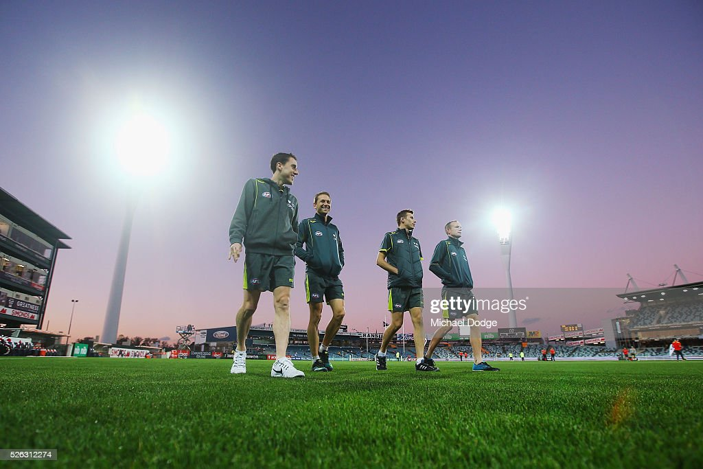 Umpires inspect the ground conditions during the round six AFL match between the Geelong Cats and the Gold Coast Suns at Simonds Stadium on April 30, 2016 in Geelong, Australia.