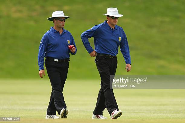 Umpires Jamie Mitchell and James Hewitt walk out onto the field during the Futures League match between Western Australia and Victoria at Stevens...