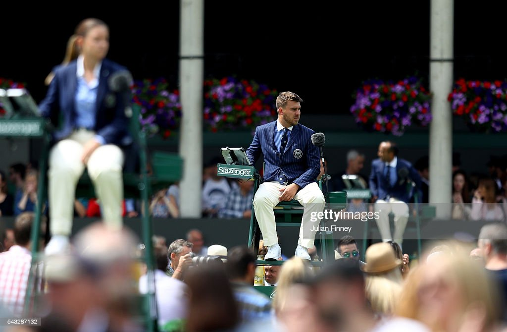Umpires look on during day one of the Wimbledon Lawn Tennis Championships at the All England Lawn Tennis and Croquet Club on June 27th, 2016 in London, England.
