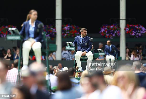 Umpires look on during day one of the Wimbledon Lawn Tennis Championships at the All England Lawn Tennis and Croquet Club on June 27th 2016 in London...