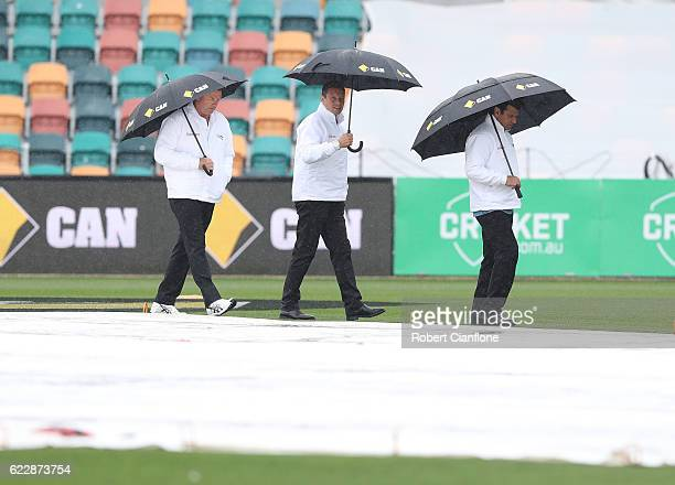 Umpires Mick Martell Richard Kettleborough and Aleem Dar inspect the pitch as rain delays play on day two of the Second Test match between Australia...
