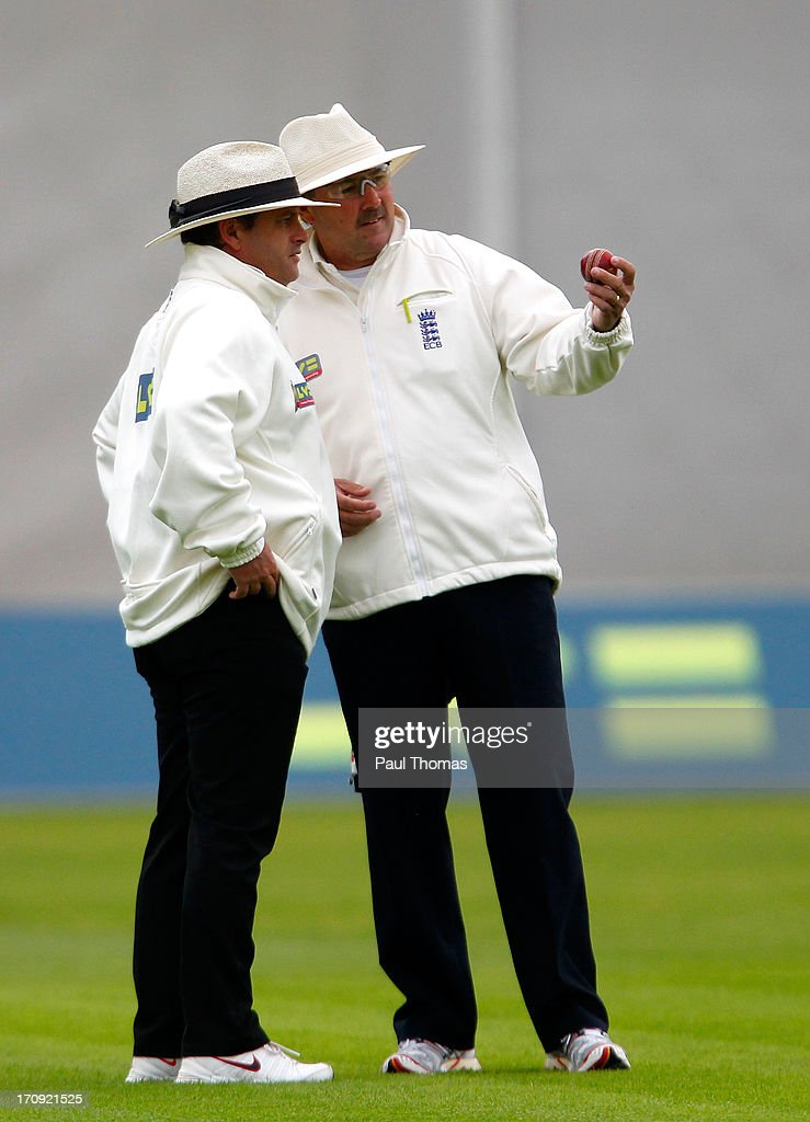 Umpires Paul Baldwin (L) and Richard Illingworth look at the ball during day one of the LV County Championship Division Two match between Lancashire and Northamptonshire at Old Trafford on June 20, 2013 in Manchester, England.