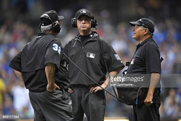 Umpires review a play during a game between the and the Chicago Cubs the Milwaukee Brewers on September 21 at Miller Park in Milwaukee WI Cubs won 53