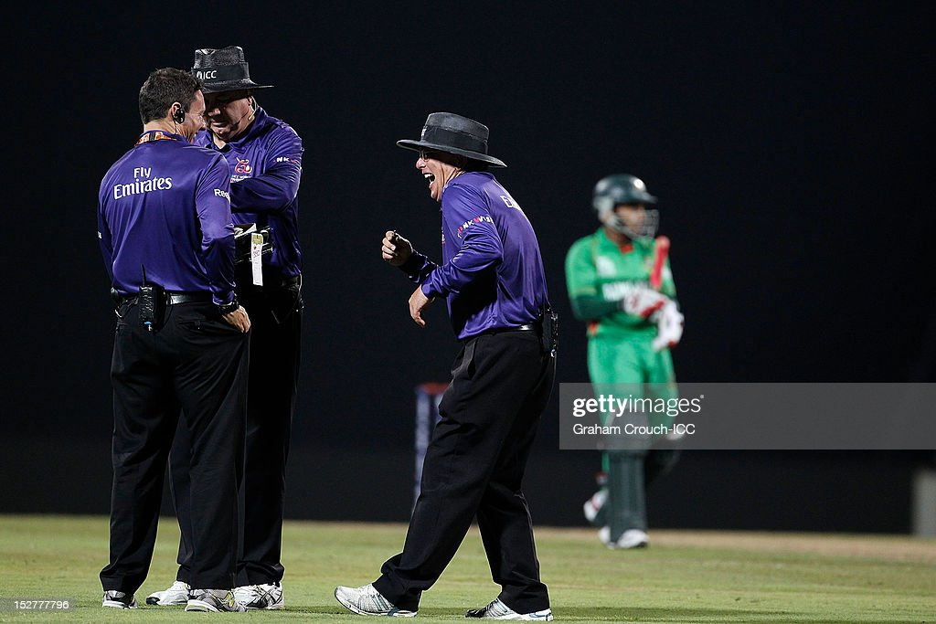 Umpires Richard Kettleborough, Steve Davis and Ian Gould officiating during the Group D match between Pakistan and Bangladesh at Pallekele Cricket Stadium on September 25, 2012 in Kandy, Sri Lanka.