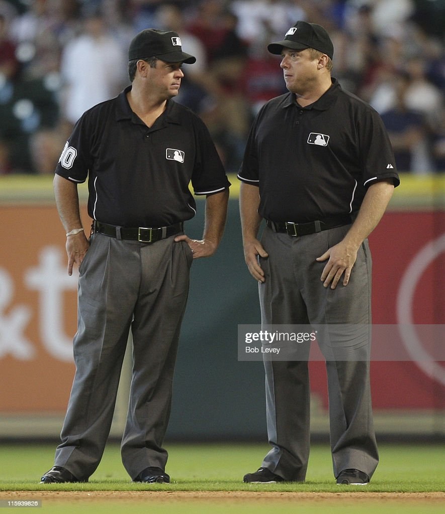 Umpires Rob Drake left and Bruce Dreckman talk between innings at Minute Maid Park on June 12 2011 in Houston Texas