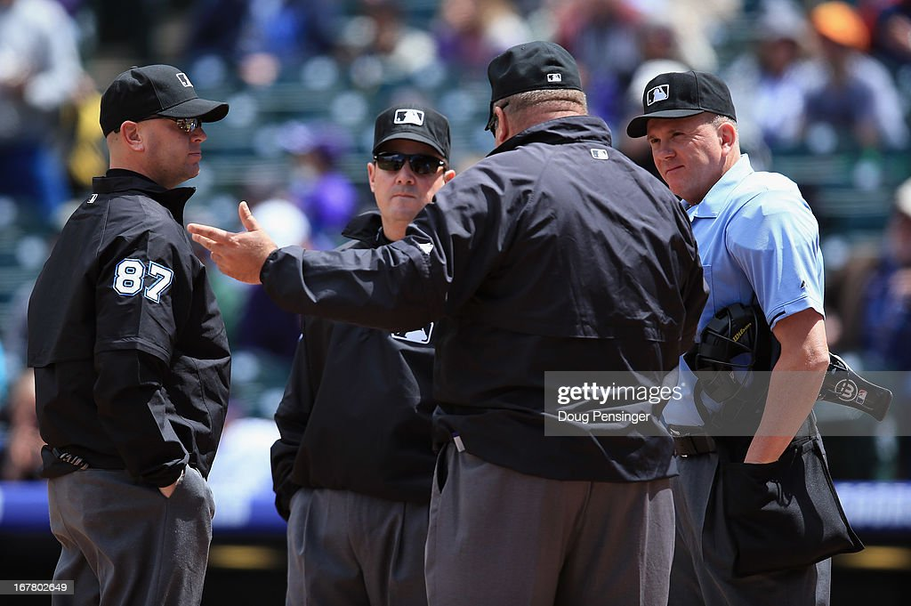 Umpires Scott Barry, Marty Foster, <a gi-track='captionPersonalityLinkClicked' href=/galleries/search?phrase=Wally+Bell&family=editorial&specificpeople=228019 ng-click='$event.stopPropagation()'>Wally Bell</a> and <a gi-track='captionPersonalityLinkClicked' href=/galleries/search?phrase=Mike+Everitt&family=editorial&specificpeople=238854 ng-click='$event.stopPropagation()'>Mike Everitt</a> talk before the start of the game between the Atlanta Braves and the Colorado Rockies at Coors Field on April 24, 2013 in Denver, Colorado. The Rockies defeated the Braves 6-5 in 12 innings.