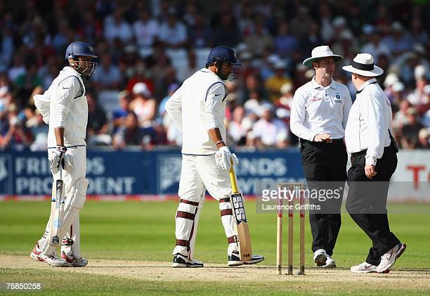 Umpires Simon Taufel with Ian Howell talk to Kevin Pietersen of England as batsmen Zaheer Khan and Anil Kumble of India look on during day three of...