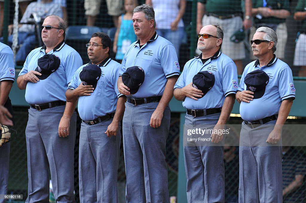 Umpires stand for the national anthem before the game between California (Chula Vista) and Asia Pacific (Taoyuan, Taiwan) in the little league world series final at Lamade Stadium on August 30, 2009 in Williamsport, Pennsylvania.