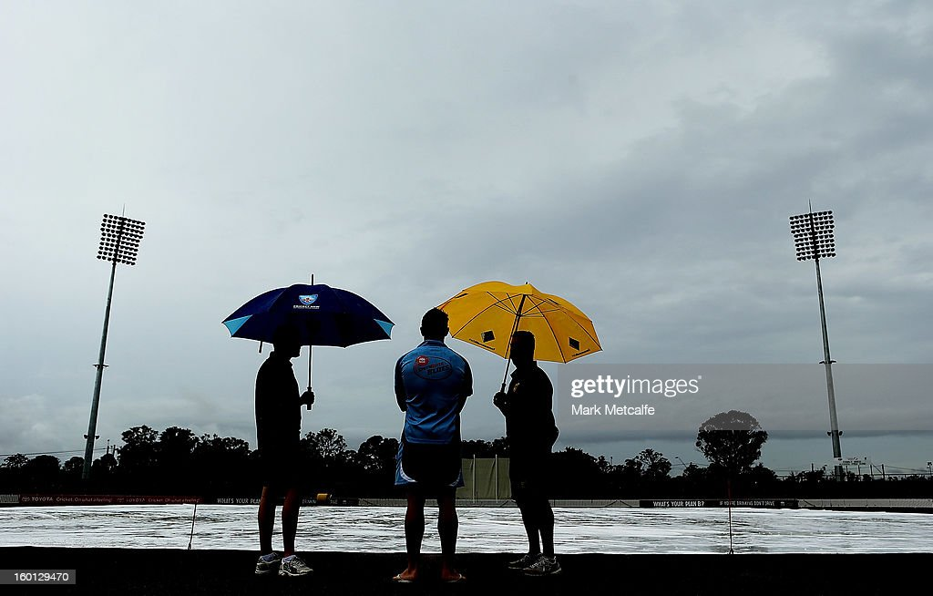 Umpires talk to Steve O'Keefe of the Blues as they inspect the ground whilst rain delays the start of day four of the Sheffield Shield match between the New South Wales Blues and the Western Australia Warriors at Bankstown Oval on January 27, 2013 in Sydney, Australia.