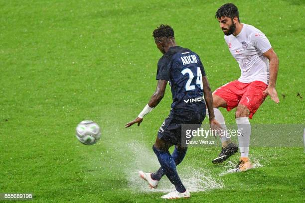 Umut Bozok of Nimes and Edmond Akichi of Paris FC during the Ligue 2 match between Paris FC and Nimes on September 29 2017 in Paris France