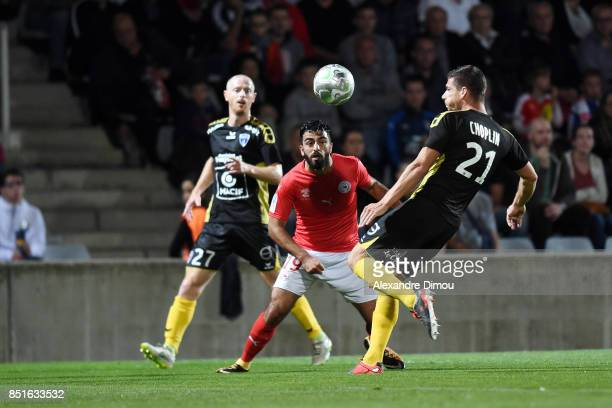 Umut Bozok of Nimes and Jeremy Choplin of Niort during the French Ligue 2 mach between Nimes and Niort at on September 22 2017 in Nimes France