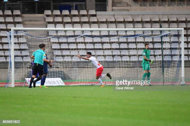 Umut Bozok of Nimes celebrates after equalising during the Ligue 2 match between Paris FC and Nimes on September 29 2017 in Paris France