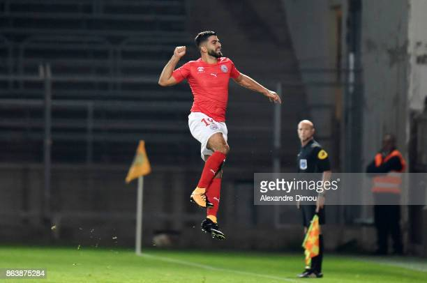 Umut Bozok of Nimes celebrates scoring his goal during the Ligue 2 match between Nimes Olympique and Brest on October 20 2017 in Nimes France