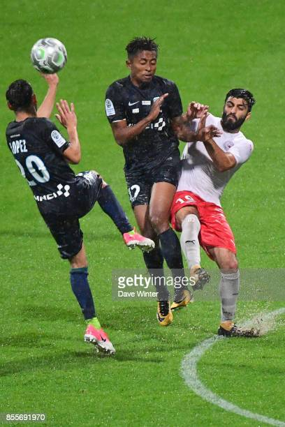 Umut Bozok of Nimes Lalaina Nomenjanahary of Paris FC and Julien Lopez of Paris FC during the Ligue 2 match between Paris FC and Nimes on September...