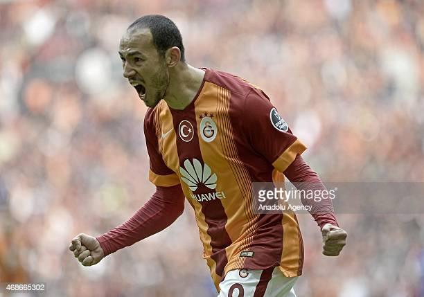Umut Bulut of Galatasaray celebrates his score during the Turkish Spor Toto Super League soccer match between Galatasaray and Kardemir Karabukspor at...