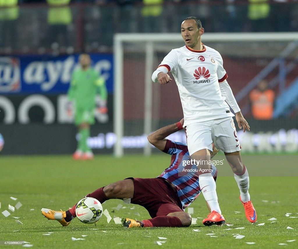 Umut Bulut (R) of Galatasaray in action against his opponent during the Turkish Spor Toto Super League soccer match between Trabzonspor and Galatasaray at Avni Aker Stadium in Turkey on April 19, 2015.